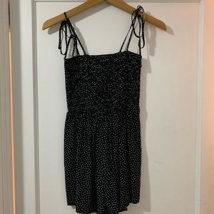 black romper with white polka dots